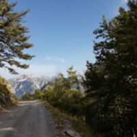 Dangerous, single lane, unpaved road  Albanian blue waters